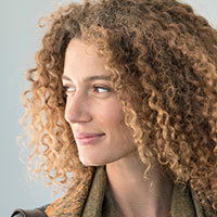 Portrait of thoughtful happy woman with curly hair