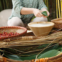 Partial view of middle-aged woman making zongzi